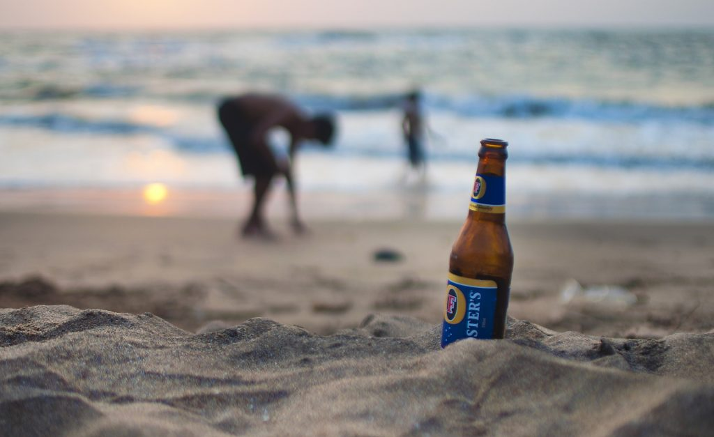 Bottle of Beer On a Beach During Sunset