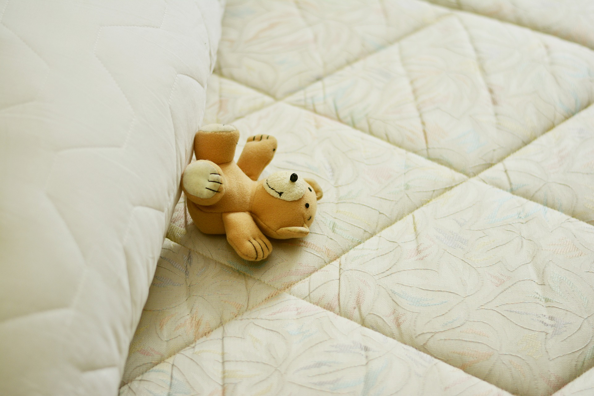 Teddy Bear Sleeping on a Mattress